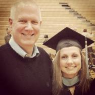 Like father, like daughter.  At my graduation for my master's.
